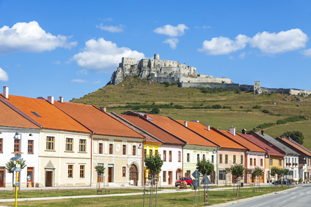 Summer view of Spisske Podhradie town with Spis Castle (Spissky hrad) on the background, Presov Region, Slova. The largest castle in Slova and one of the largest castle compounds in Central Europe Reklamní fotografie - 69451805