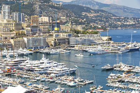 monte carlo: Monte Carlo city skyline panorama. Close-up view of luxury yachts and apartments in harbor of Monte Carlo, Monaco, Cote dAzur