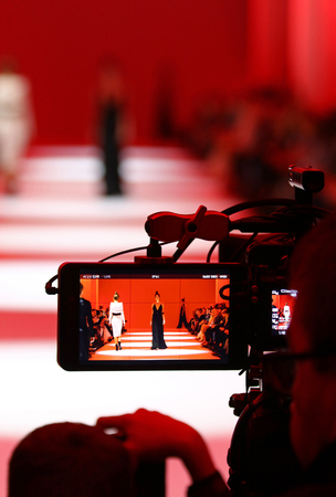KYIV, UKRAINE - OCTOBER 13, 2016: Televison Camera Broadcasting a Fashion show by Yana CHERVINSKA as part of SpringSummer 2017 presentation during 39th Ukrainian Fashion Week at Mystetskyi Arsenal