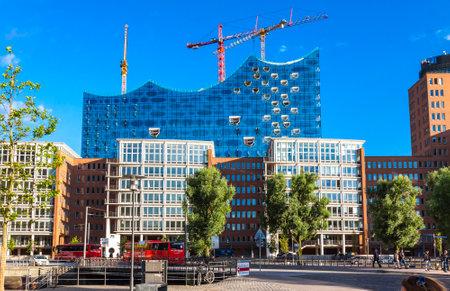 HAMBURG, GERMANY - JUNE 25, 2014: City of Warehouses district (Speicherstadt) in Hamburg, Germany. Building of Elbphilharmonie (Elbe Philharmonic Hall) on the background