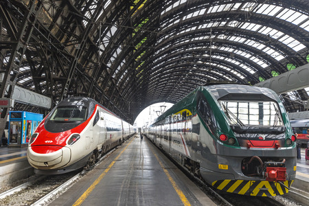 MILAN, ITALY - JUNE 14, 2016: Train SBB (Left) and Trenord companies on platforms of the Milan Central Railway Station (Milano Centrale). It is the main railway station of Milan, Italy. Opened in 1931