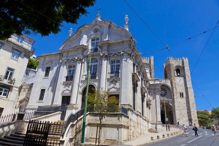View of the main facade of Santo Antonio Church (Igreja de Santo Antonio) with the Lisbon Cathedral (Se de Lisboa) on background. Lisbon, Portugal Stock Photo