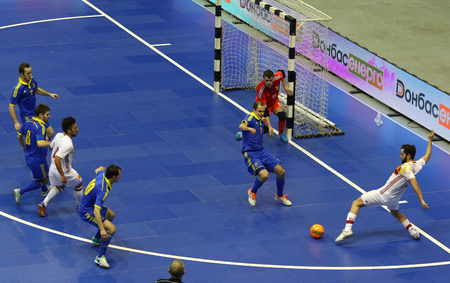 KYIV, UKRAINE - JANUARY 29, 2017: Players of Spain (in White) and Ukraine (in Blue) teams in action during their Friendly Futsal match at Palats of Sports in Kyiv, Ukraine