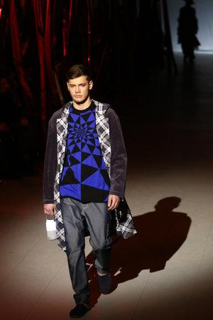 KYIV, UKRAINE - FEBRUARY 7, 2017: Model presents a creation by designer Oleksiy ZALEVSKIY during 40th Ukrainian Fashion Week season AutumnWinter 201718 at Mystetskyi Arsenal in Kyiv, Ukraine Editorial