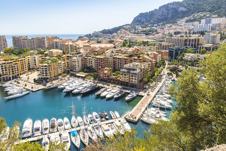 Panoramic view of Port de Fontvieille in Principality of Monaco. French Riviera. Colorful bay with a lot of luxury yachts and high-rise apartment complexes