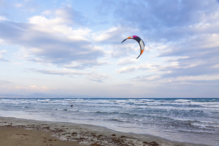 Kitesurfing in a cloudy autumn day. Ladys Mile beach in Limassol, Cyprus