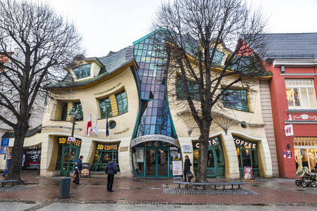 SOPOT, POLAND - NOVEMBER 30, 2016: Crooked little house (Polish: Krzywy Domek) is an unusually shaped building in Sopot, Poland. Built in 2004, its part of the Rezydent shopping center