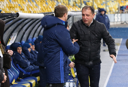 luhansk: KYIV, UKRAINE - OCTOBER 26, 2016: FC Dynamo Kyiv manager Sergiy Rebrov (L) shakes hands with Zorya Luhansk manager Yuriy Vernydub before Cup of Ukraine game against  at NSC Olympic stadium in Kyiv Editorial
