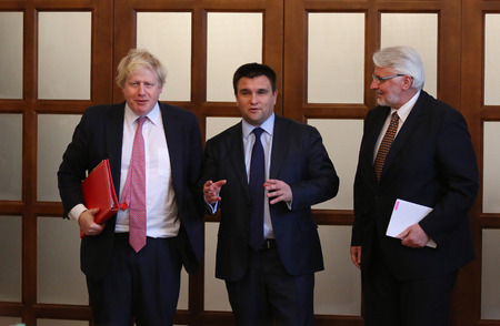 foreign secretary: KYIV, UKRAINE - MARCH 1, 2017: Secretary of State for Foreign Affairs of UK Boris Johnson (L), Foreign Minister of Ukraine P.Klimkin (C) and Foreign Minister of Poland W.Waschykovskyi in Kyiv