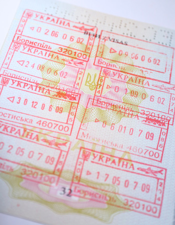 Page of Passport with Ukrainian entry and exit stamps Stock Photo