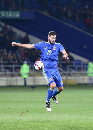 striker: Kharkiv, Ukraine - November 15, 2016: Yevhen Shakhov of Ukraine controls a ball during Friendly match against Serbia at Metalist stadium in Kharkiv, Ukraine