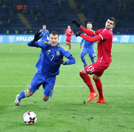 Kharkiv, Ukraine - November 15, 2016: Andriy Yarmolenko of Ukraine (L) awards a penalty kick during Friendly match against Serbia at Metalist stadium in Kharkiv, Ukraine. Ukraine won 2-0 Editorial