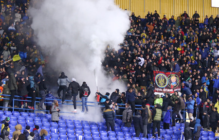 Kharkiv, Ukraine - November 15, 2016: Ukrainian ultra supporters (ultras) burn flares during Friendly match between Ukraine and Serbia at Metalist stadium in Kharkiv, Ukraine. Ukraine won 2-0 Editorial