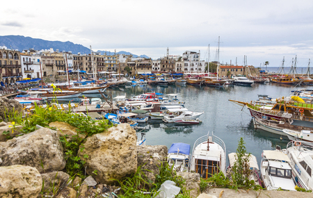 KYRENIA, CYPRUS - JANUARY 19, 2015: Winter view of Kyrenia old harbour in Northern Cyprus. Kyrenia (Turkish: Girne) is a city on the northern coast of Cyprus, noted for its historic harbour and castle