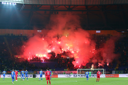 pyro: Kharkiv, Ukraine - November 15, 2016: Ukrainian ultra supporters (ultras) burn flares during Friendly match between Ukraine and Serbia at Metalist stadium in Kharkiv, Ukraine. Ukraine won 2-0 Editorial