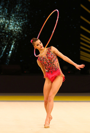 alexandra: KYIV, UKRAINE - MARCH 18, 2017: Rhythmic gymnast Alexandra Kis of Hungary performs with Hoop during Rhytmic Gymnastics Grand Prix Deriugina Cup in Palace of Sports in Kyiv, Ukraine Editorial