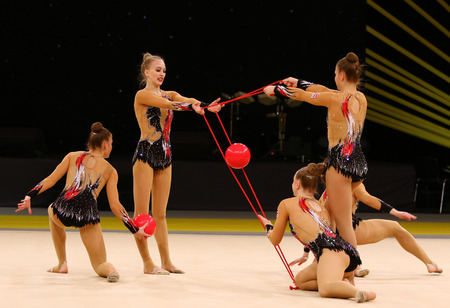 KYIV, UKRAINE - MARCH 19, 2017: Team of Latvia performs with 3 Balls and 2 Ropes during Group Competition of Rhythmic Gymnastics Grand Prix Deriugina Cup in Palace of Sports in Kyiv, Ukraine