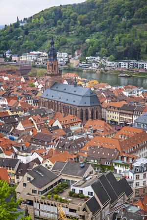 Aerial view of Heidelberg city, Baden-Wurttemberg state, Germany. Old town (Altstadt) and Church of the Holy Spirit (Heiliggeistkirche) on a foreground.