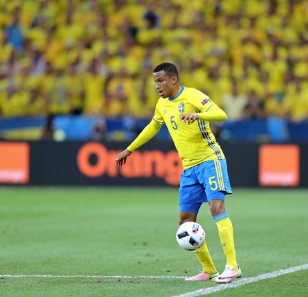 match head: NICE, FRANCE - JUNE 22, 2016: Martin Olsson of Sweden controls a ball during UEFA EURO 2016 game against Belgium at Allianz Riviera Stade de Nice, City of Nice, France