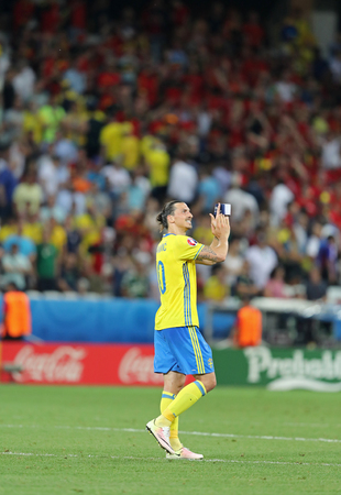 striker: NICE, FRANCE - JUNE 22, 2016: Zlatan Ibrahimovic of Sweden thanks fans after UEFA EURO 2016 game against Belgium at Allianz Riviera Stade de Nice. The last match of Ibrahimovic for the National Team Editorial