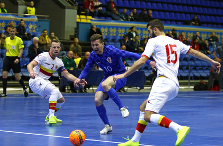 KYIV, UKRAINE - April 8, 2017: Tihomir Novak of Croatia (C) fights for a ball with Vedran Matosevic (L) and Aleksandar Obradovic of Montenegro during their UEFA Futsal Euro 2018 qualifying game