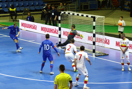l first: KYIV, UKRAINE - April 8, 2017: Josip Suton of Croatia (first from L) scores a goal during UEFA Futsal Euro 2018 qualifying game against Montenegro at Palats of Sports in Kyiv, Ukraine