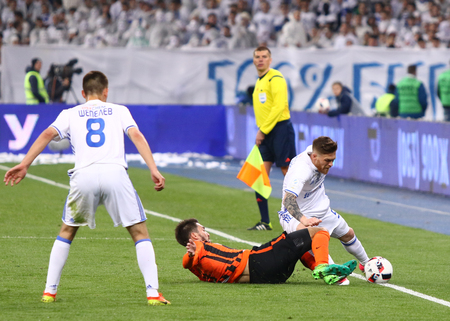 KYIV, UKRAINE - APRIL 21, 2017: Antunes of FC Dynamo Kyiv (R) fights for a ball with Facundo Ferreyra of Shakhtar Donetsk (C) during their Ukrainian Premier League game at NSC Olimpiyskyi stadium Editorial