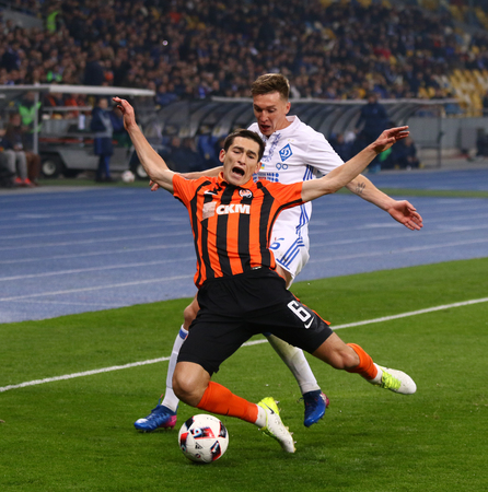KYIV, UKRAINE - APRIL 21, 2017: Serhiy Sydorchuk of FC Dynamo Kyiv (R) fights for a ball with Taras Stepanenko of Shakhtar Donetsk during their Ukrainian Premier League game at NSC Olimpiyskyi stadium