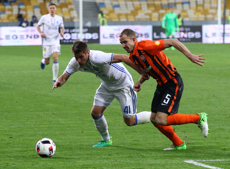 KYIV, UKRAINE - APRIL 21, 2017: Artem Besedin of FC Dynamo Kyiv (L) fights for a ball with Oleksandr Kucher of Shakhtar Donetsk (C) during their Ukrainian Premier League game in Kyiv, Ukraine