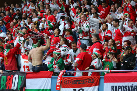 KYIV, UKRAINE - APRIL 22, 2017: Hungarian fans celebrate after the IIHF 2017 Ice Hockey World Championship Div 1 Group A game against Ukraine at Palace of Sports in Kyiv, Ukraine