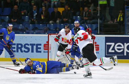 icehockey: KYIV, UKRAINE - APRIL 22, 2017: Ukrainian players (in Blue) defend their net during IIHF 2017 Ice Hockey World Championship Div 1 Group A game against Hungary at Palace of Sports in Kyiv, Ukraine