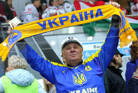 KYIV, UKRAINE - APRIL 22, 2017: Ukrainian fan shows his support during IIHF 2017 Ice Hockey World Championship Div 1 Group A game against Hungary at Palace of Sports in Kyiv, Ukraine
