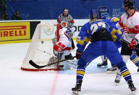 KYIV, UKRAINE - APRIL 22, 2017: Sergiy KUZMIK of Ukraine (#27) scores a goal during IIHF 2017 Ice Hockey World Championship Div 1 Group A game against Hungary at Palace of Sports in Kyiv, Ukraine