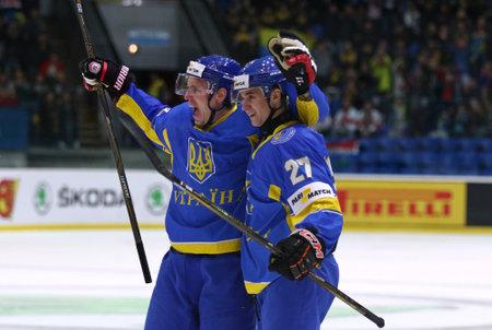 KYIV, UKRAINE - APRIL 22, 2017: Denys ISAYENKO (L) and Sergiy KUZMIK of Ukraine celebrate after scored a goal during IIHF 2017 Ice Hockey World Championship Div 1 Group A game against Hungary Editorial