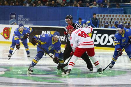 KYIV, UKRAINE - APRIL 23, 2017: Referee face-off the rink during IIHF 2017 Ice Hockey World Championship Div 1 Group A game Ukraine v Poland. Poland won 2-1