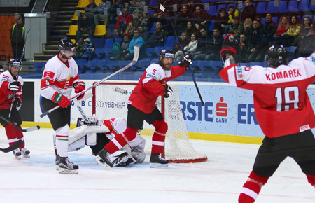 icehockey: KYIV, UKRAINE - APRIL 24, 2017: Austrian players (in Red) celebrate after scored a goal during IIHF 2017 Ice Hockey World Championship Div 1 Group A game against Hungary at Palace of Sports in Kyiv Editorial