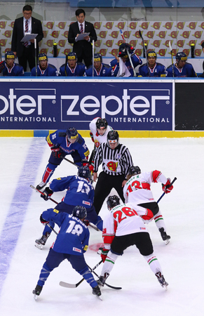 KYIV, UKRAINE - APRIL 25, 2017. Referee face-off the rink during IIHF 2017 Ice Hockey World Championship Div 1 Group A game Hungary v South Korea at Palace of Sports in Kyiv, Ukraine