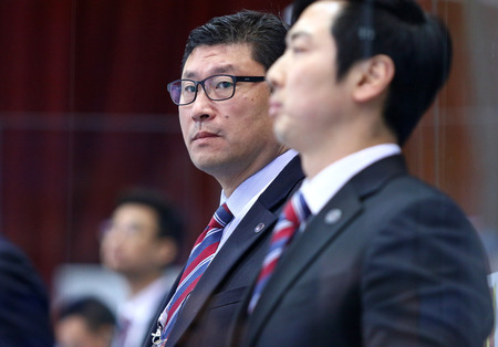 KYIV, UKRAINE - APRIL 25, 2017: Head coach of South Korea National Team Jim PAEK looks on during IIHF 2017 Ice Hockey World Championship Div 1 Group A game against Hungary at Palace of Sports in Kyiv