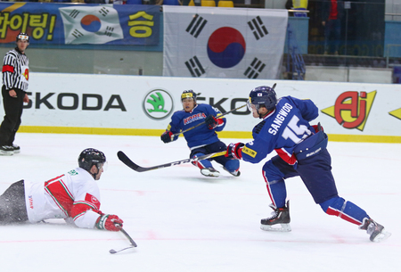 KYIV, UKRAINE - APRIL 25, 2017: SIN Sangwoo of South Korea (R) scores during IIHF 2017 Ice Hockey World Championship Div 1 Group A game against Hungary at Palace of Sports in Kyiv, Ukraine