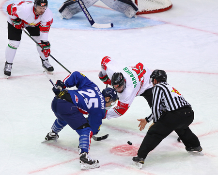 KYIV, UKRAINE - APRIL 25, 2017: Referee face-off the rink during IIHF 2017 Ice Hockey World Championship Div 1 Group A game Hungary v South Korea at Palace of Sports in Kyiv, Ukraine
