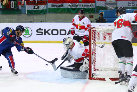 icehockey: KYIV, UKRAINE - APRIL 25, 2017: KIM Kisung of South Korea (L) scores during IIHF 2017 Ice Hockey World Championship Div 1 Group A game against Hungary at Palace of Sports in Kyiv, Ukraine Editorial