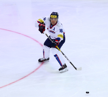 KYIV, UKRAINE - APRIL 27, 2017: LEE Don Ku of South Korea in action during IIHF 2017 Ice Hockey World Championship Div 1 Group A game against Austria at Palace of Sports in Kyiv, Ukraine