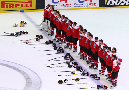 KYIV, UKRAINE - APRIL 27, 2017: Team of Austria listen to National anthem after the IIHF 2017 Ice Hockey World Championship Div 1 Group A game against South Korea at Palace of Sports in Kyiv, Ukraine