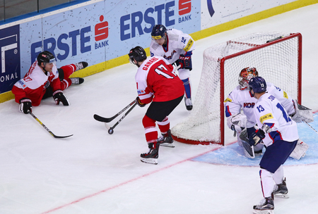 icehockey: KYIV, UKRAINE - APRIL 27, 2017: IIHF 2017 Ice Hockey World Championship Div 1 Group A game Austria (Red jersey) v South Korea (White jersey) at Palace of Sports in Kyiv, Ukraine