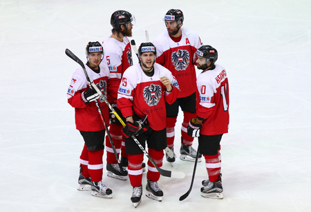 KYIV, UKRAINE - APRIL 27, 2017: Austrian players F.HOFER (#22), T.RAFFL (#5), K.KOMAREK (#19), D.HEINRICH (#10) and M.SCHUMNIG (#28) during IIHF 2017 Ice Hockey WC Div 1A game against South Korea