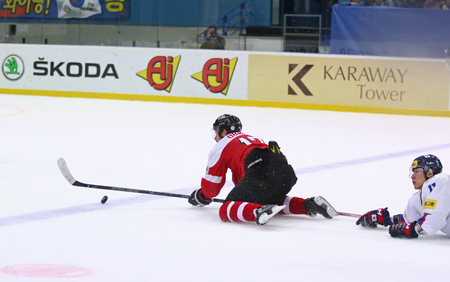 KYIV, UKRAINE - APRIL 27, 2017: Patrick OBRIST of Austria (L) fights for a puck with Kim Kisung of South Korea during their IIHF 2017 Ice Hockey World Championship Div 1A game at Palace of Sports