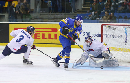 icehockey: KYIV, UKRAINE - APRIL 28, 2017: IIHF 2017 Ice Hockey World Championship Div 1A game Ukraine (Blue jersey) vs South Korea (White jersey) at Palace of Sports in Kyiv, Ukraine Editorial