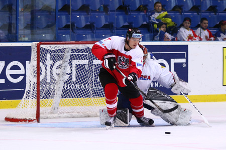 KYIV, UKRAINE - APRIL 27, 2017: Forward Brian LEBLER of Austria and goalkeeper PARK Sungje of South Korea in action during their IIHF 2017 Ice Hockey World Championship Div 1A game at Palace of Sports Editorial