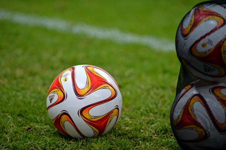 WARSAW, POLAND - MAY 27, 2015: Official UEFA Europa League match ball on the grass during Training session before UEFA Europa League Final game Dnipro vs Sevilla at Stadion Narodowy in Warsaw, Poland