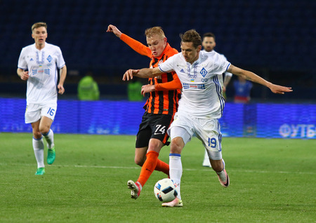 KHARKIV, UKRAINE - MAY 17, 2017: Denys Garmash of Dynamo Kyiv (R) fights for a ball with Viktor Kovalenko of Shakhtar Donetsk during their Cup of Ukraine Final game at OSC Metalist stadium in Kharkiv
